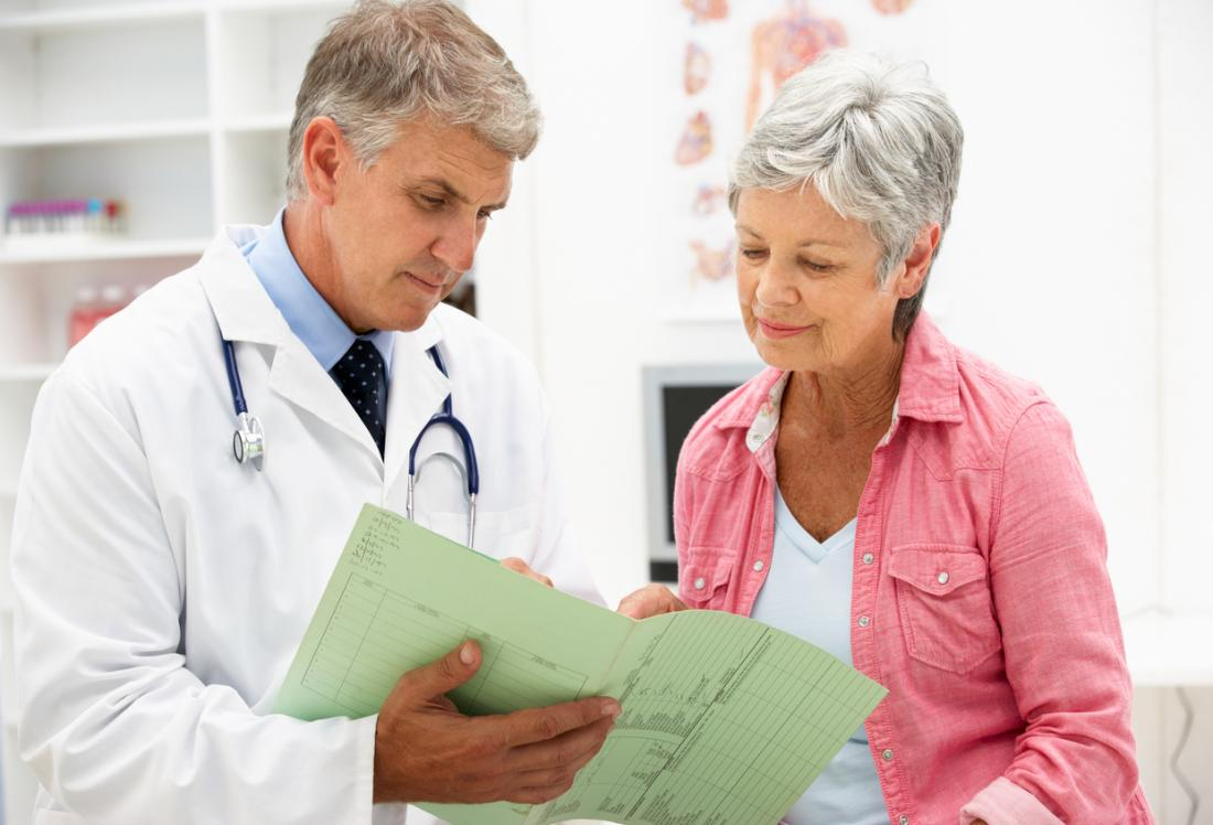 Mature senior woman with male doctor.