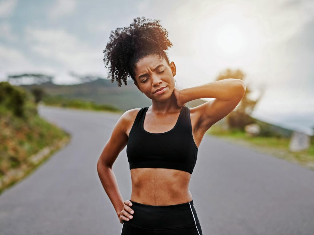 a female runner who is Working out when sore