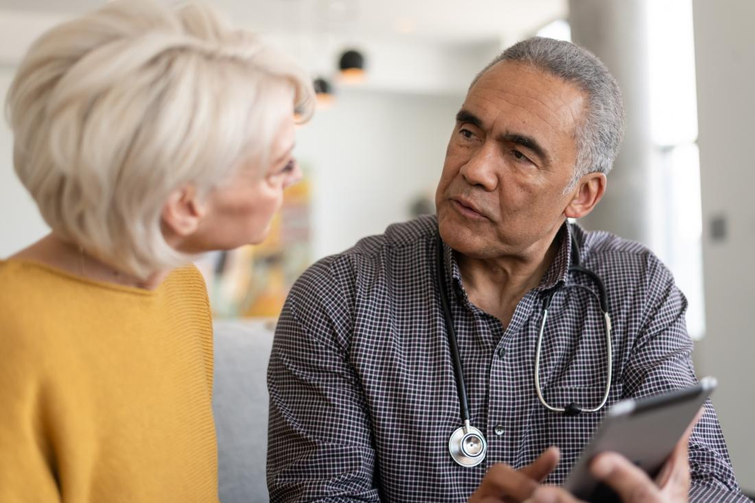 senior patient talking to doctor