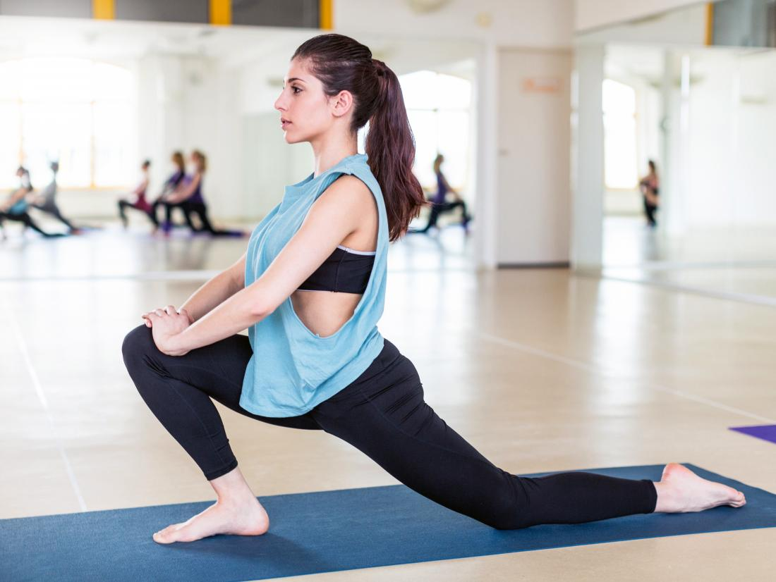 a woman doing a hip opener stretch