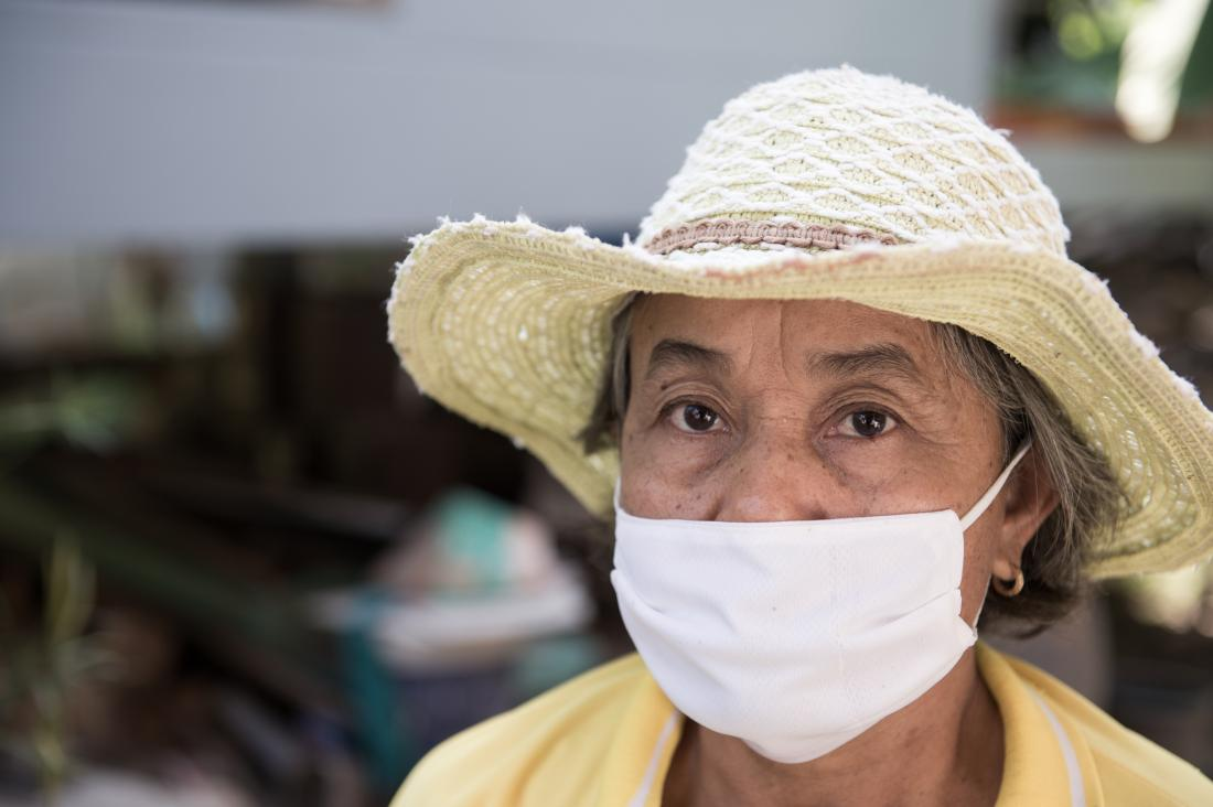 older woman wearing surgical mask