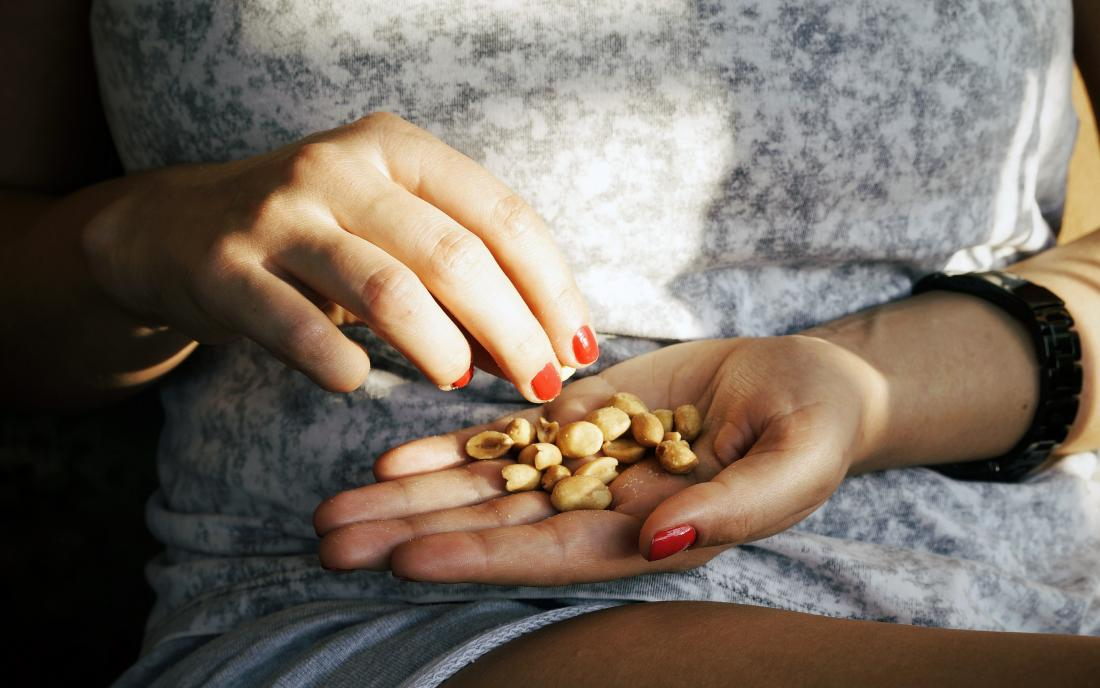 a woman eating nuts as a source of choline