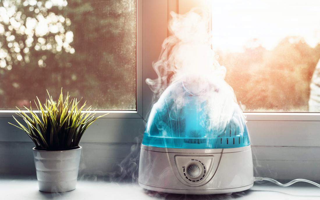 a Air humidifier doing work on a windowsill