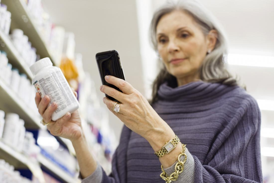 a woman looking at NAC in a pharmacy
