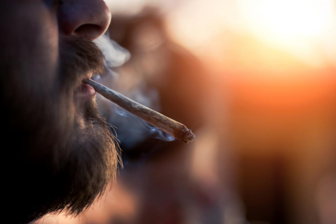 person smoking a joint