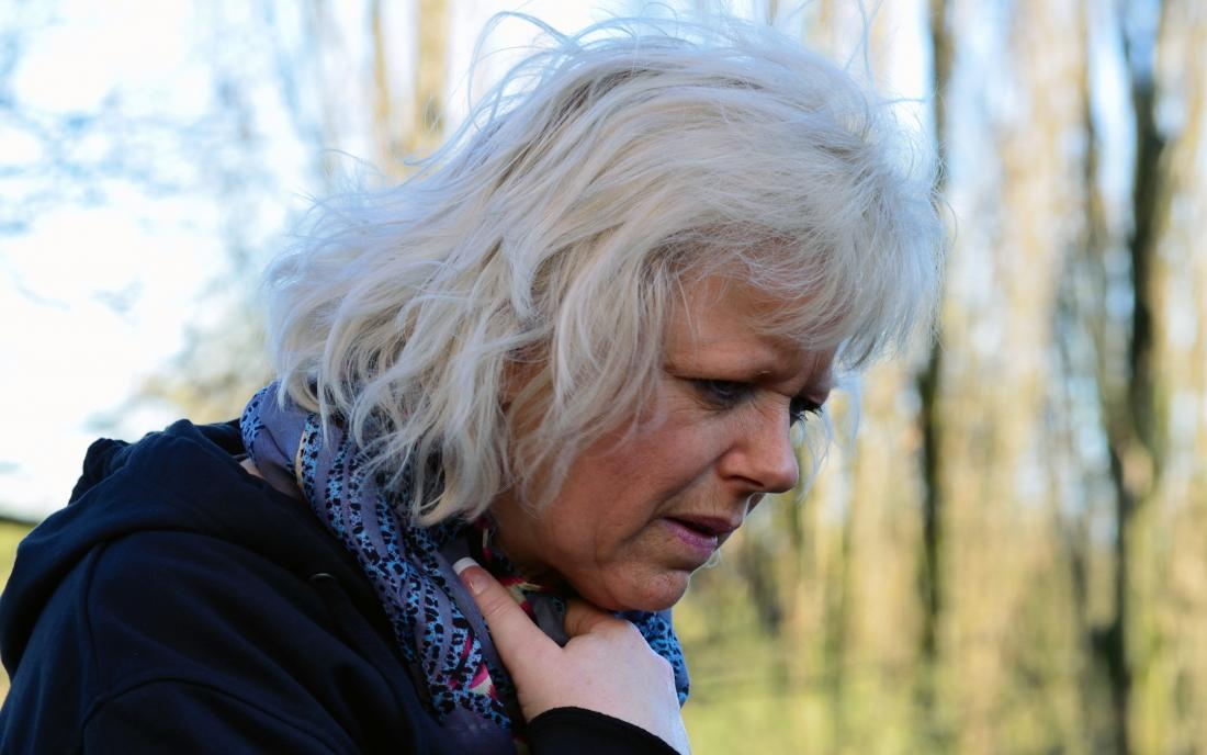 a senior woman experiencing symptoms of bronchitis