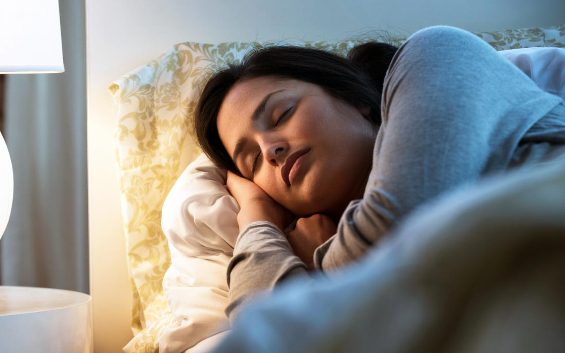a woman Elevating her head to help her stuffy nose while she sleeps