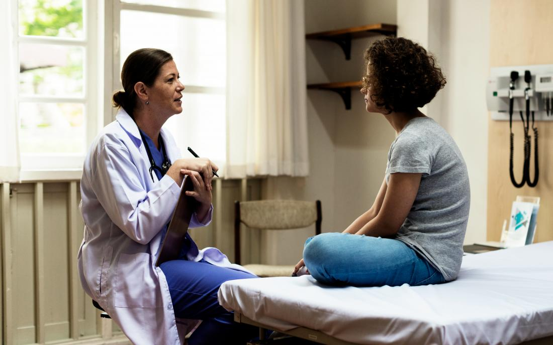 a doctor discussing non hodgkins lymphoma with a female patient