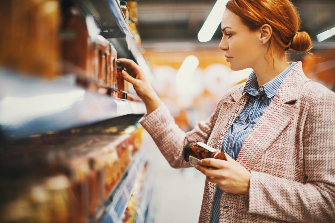 woman choosing foods off a shelf