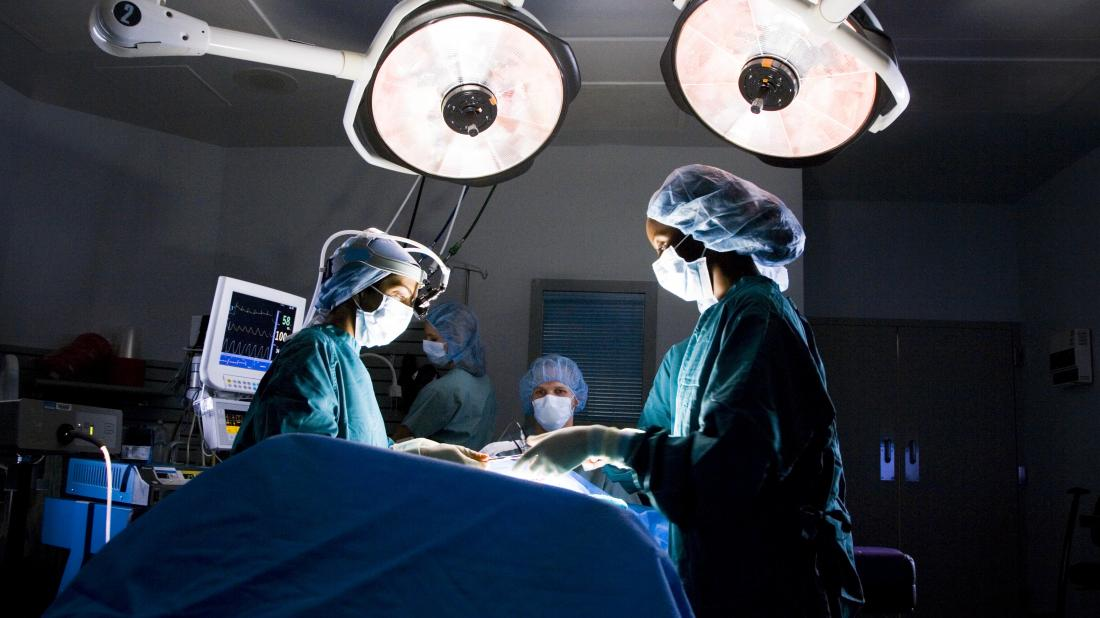 surgeons performing Breast reduction surgery