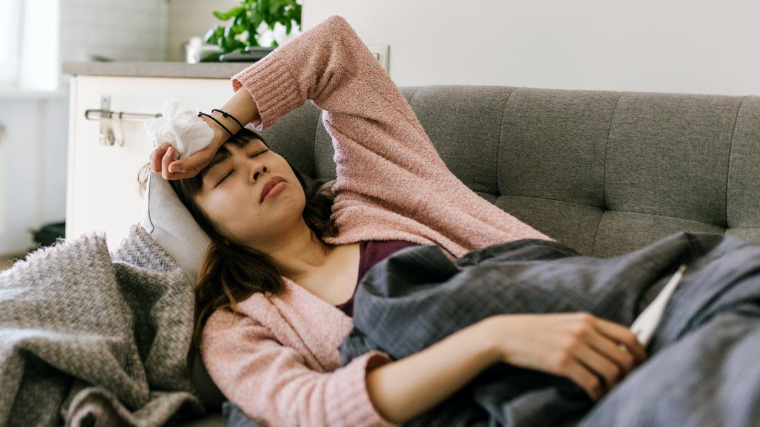 a person lying on the sofa with a fever because of meningococcal disease