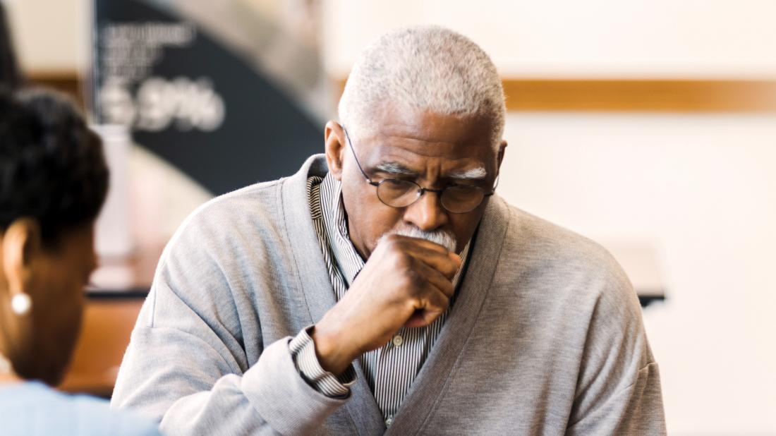 a man coughing because he has early signs of lung cancer