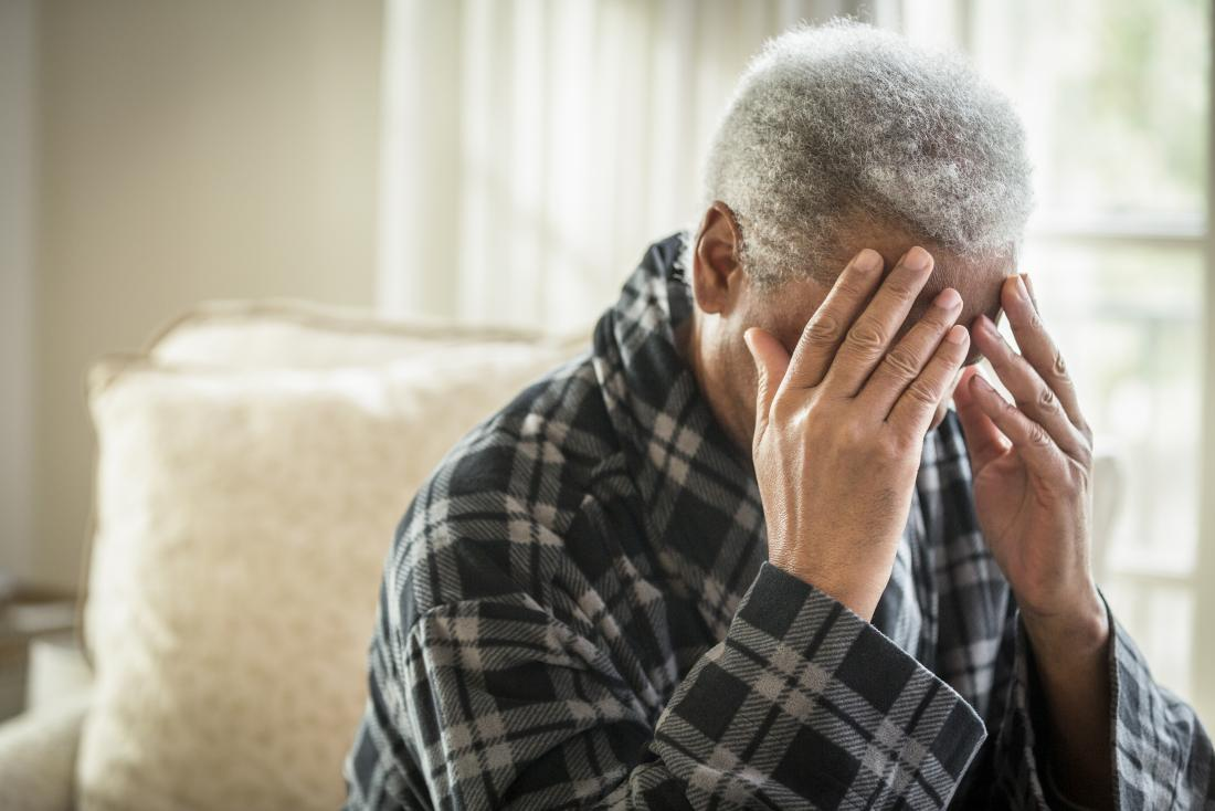 a person experiencing a headache as they have the early signs of shingles