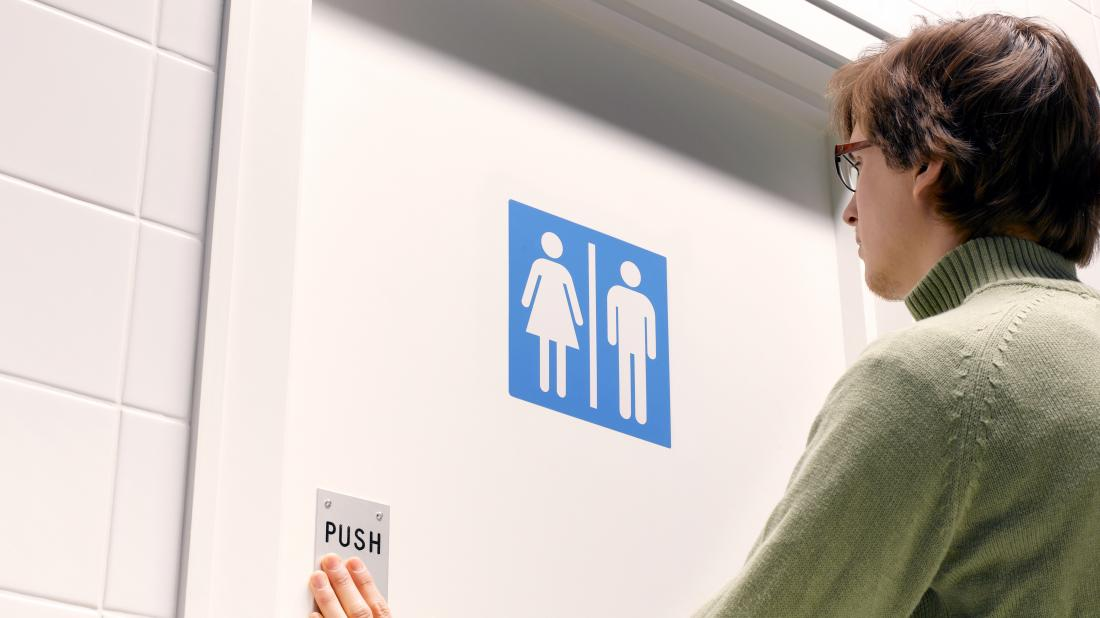 a person going to the toilet because they have urinary retention