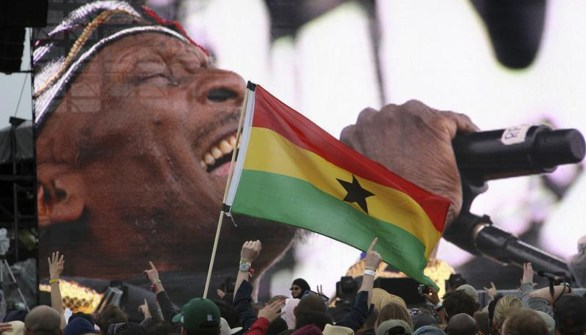 A Ghana flag is waved as fans watch Jimmy Cliff perform at Coachella, 2012 (Reuters)