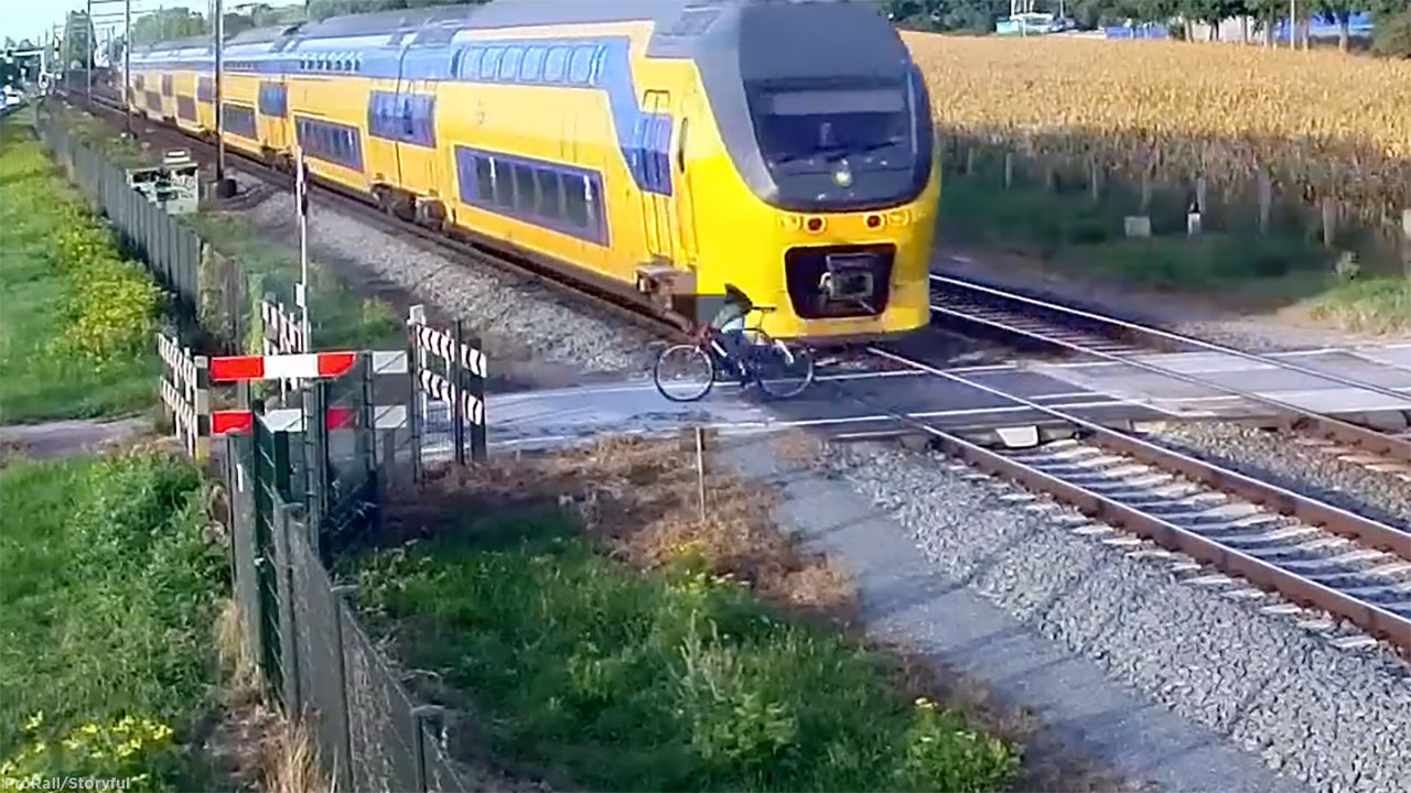 Bios Veldhoven Dutch Cyclist Has Harrowing Close Call With Oncoming Train Video
