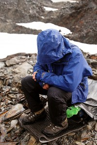 Backpacker protecting himself from threat of lightning strike, Bailey Range, Olympic Mountains