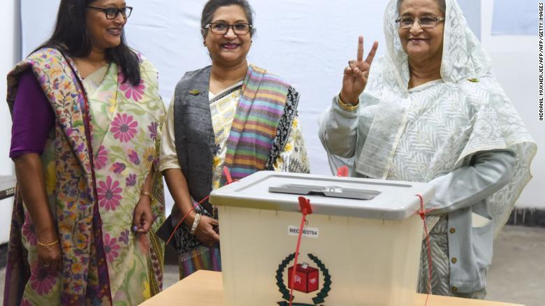 Bangladeshi Prime Minister Sheikh Hasina flashes the victory symbol after casting her vote in Dhaka on December 30, 2018.