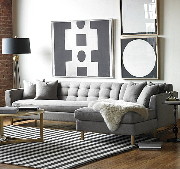 chestnut furniture set against slate gray walls gives this living - gray and gold living room