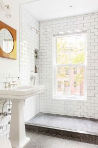 Small modern bathroom with glass shower area and penny ...