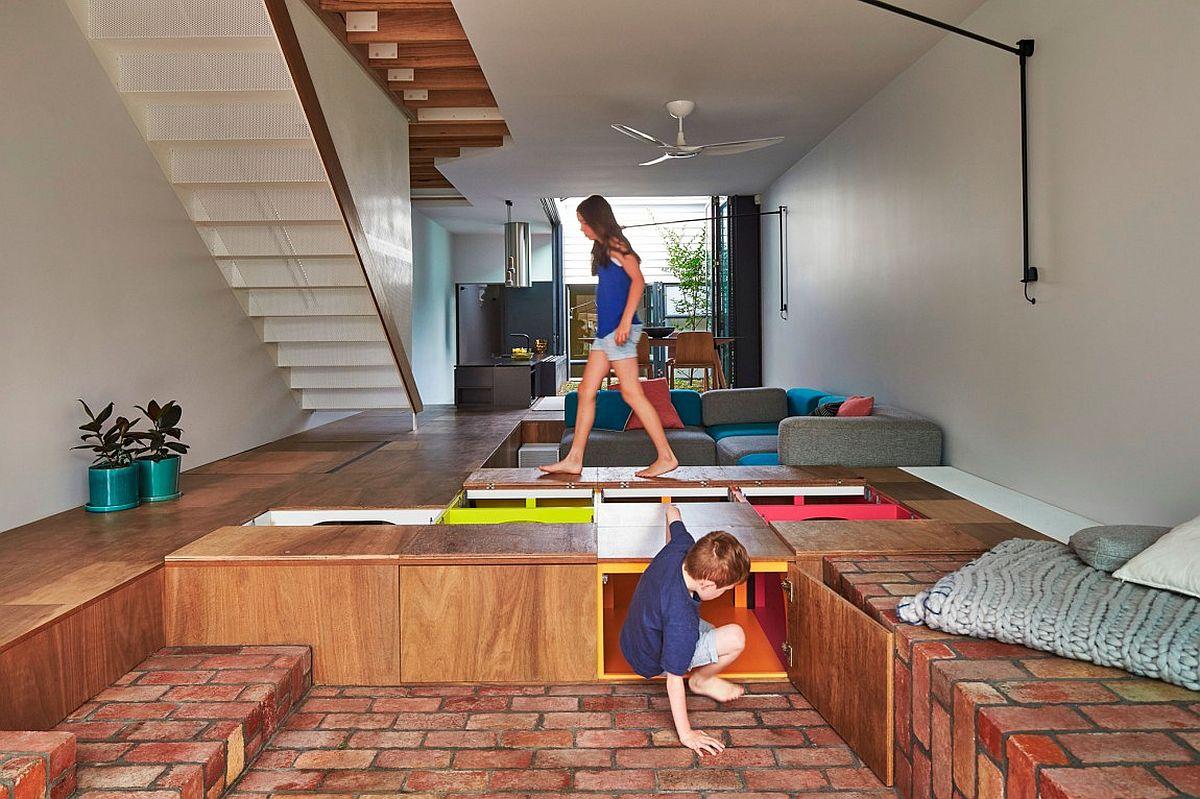 Custom Design Turns The Floor Into Toy Storage Space