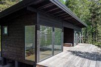 Modern Scandinavian Log Cabin Set on a Beautiful Baltic ...