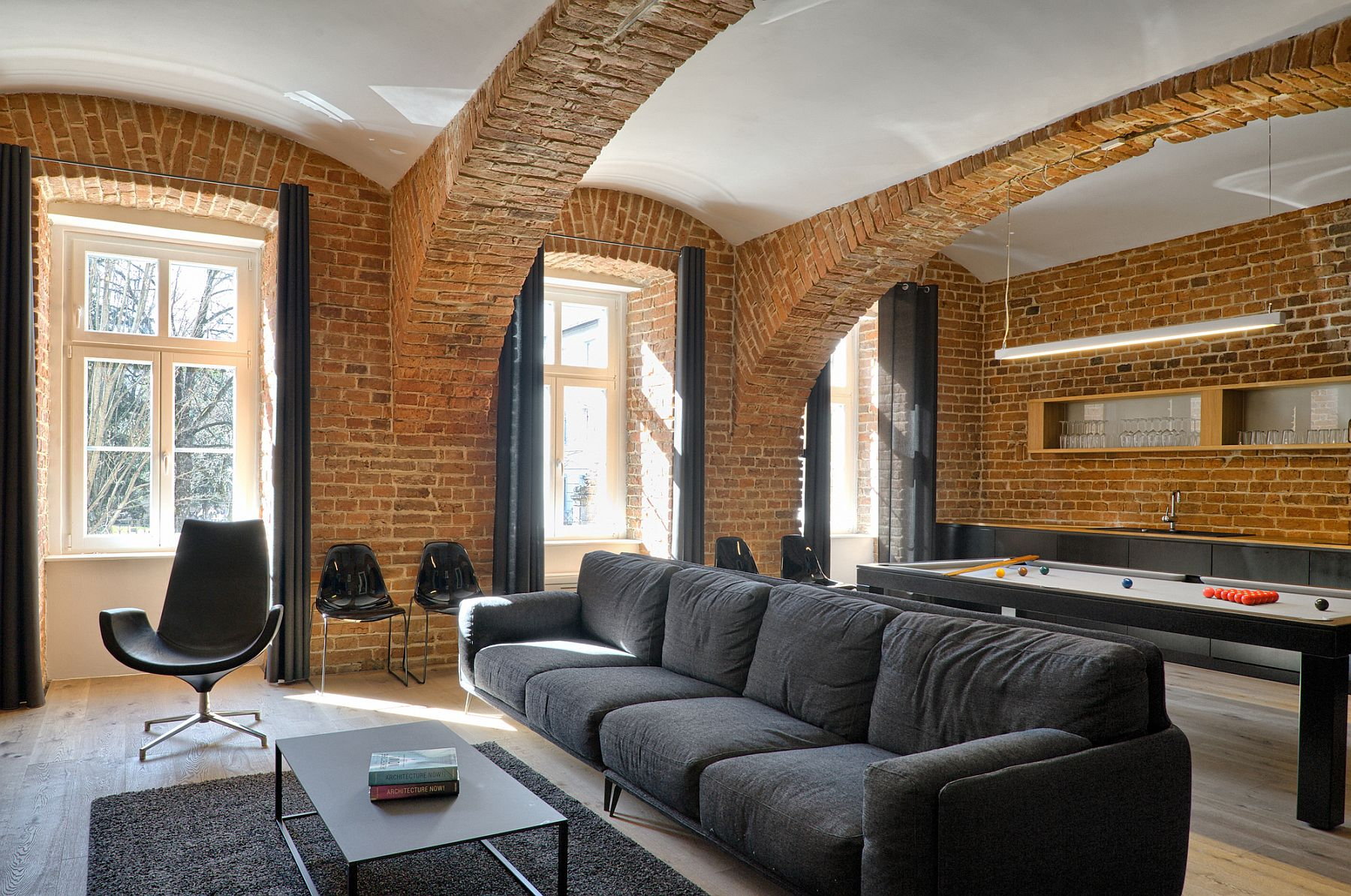 Apartments With Exposed Brick Modern Apartment Of A Football Player Celebrates The