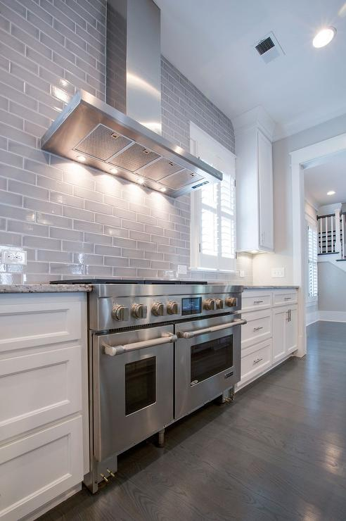 white gray kitchen features white cabinets paired white kitchen backsplash