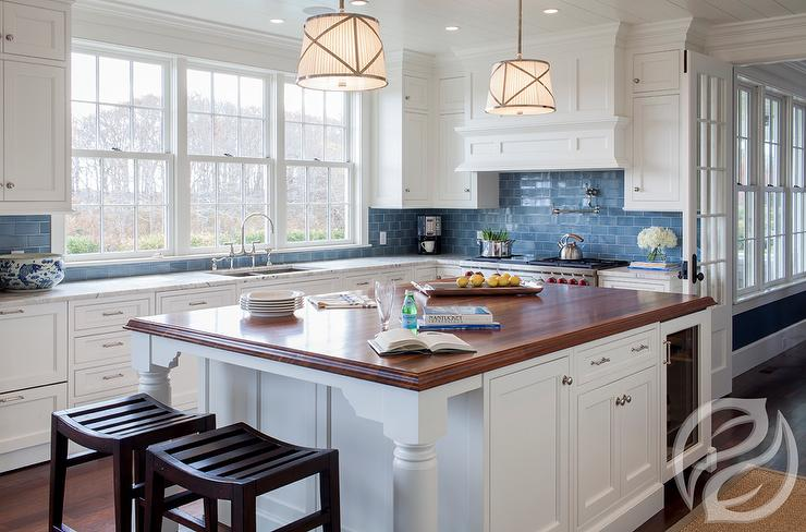 white kitchen cabinets blue subway tiles transitional kitchen kitchen rich brown cabinetry mosaic tile backsplash hgtv
