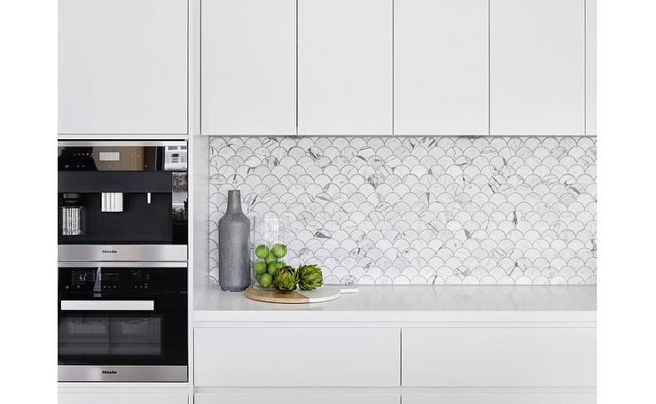 modern kitchen features white lacquered flat front cabinets paired white countertop modern kitchen backsplash tile