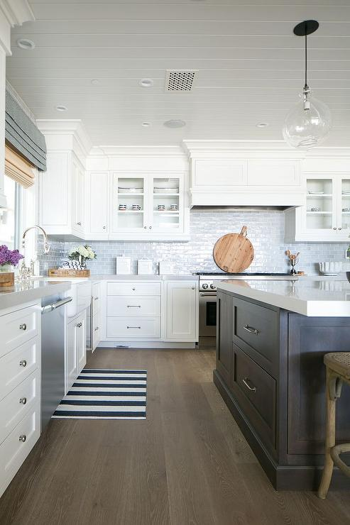 arrow keys view kitchens swipe photo view kitchens kitchen rich brown cabinetry mosaic tile backsplash hgtv