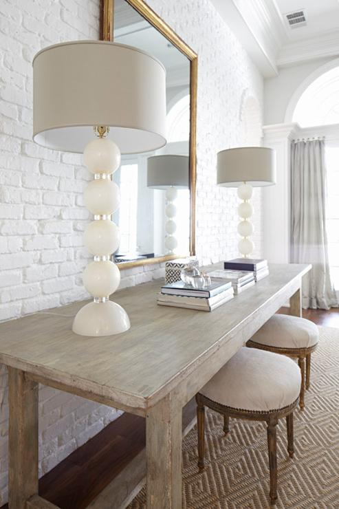 Rug Under Round Dining Table Living Room With White Brick Walls - Transitional - Living