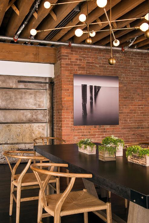 Battery Chandelier Loft Dining Room With Exposed Brick Walls - Modern