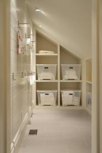 Laundry Room with Sloped Ceiling and Built In Cubbies ...