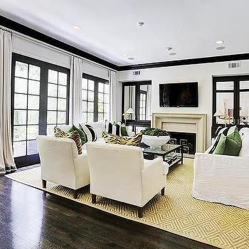 White and Black Living Room with Emerald Green Accents - black and white living rooms