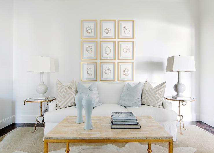 White Skirted Sofa with Round Brass and Mirror End Tables