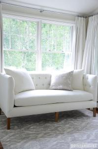 White and Grey Bedroom with White Tufted Sofa ...