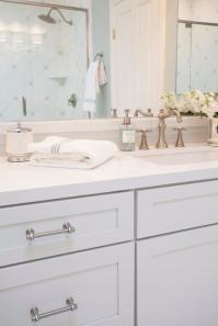 White Shaker Vanity Cabinets with Gray Glass Tile ...