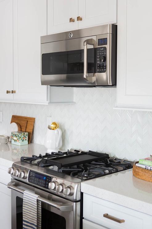 white glass herringbone kitchen tiles arizona tiles transitional white kitchen cabinet glass metal backsplash tile backsplash