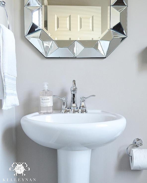 Powder Room Pedestal Sink With Geometric Mirror