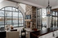 Contemporary Cabin Living Room with Arched Windows ...