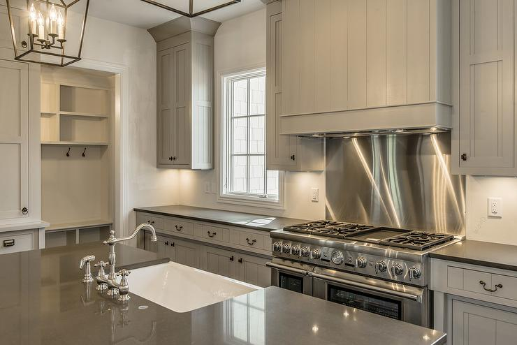 gray shiplap kitchen hood stainless steel cooktop backsplash white cabinets grey backsplash kitchen subway tile outlet