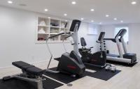 Basement Gym with Mirrored Walls and Wood Floors ...