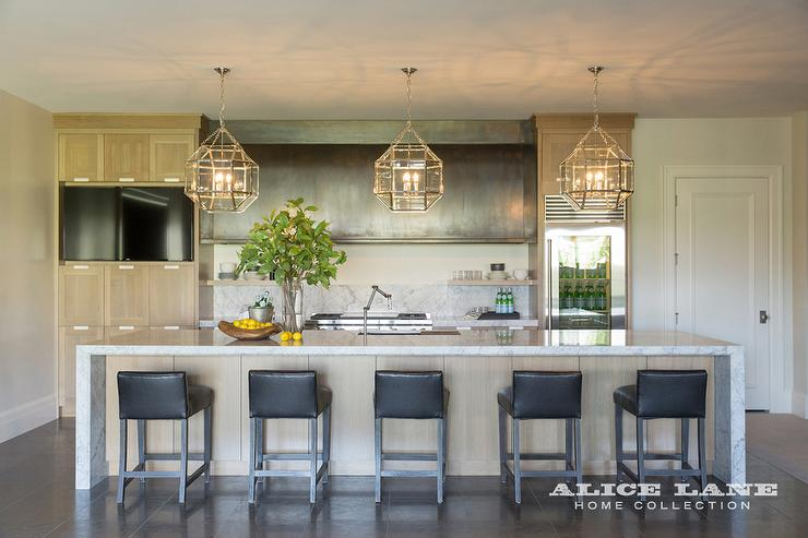 Long Barrel Zinc Kitchen Hood with Honey Colored Cabinets