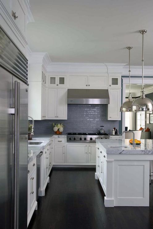 blue kitchen island dark woof countertop contemporary kitchen kitchen rich brown cabinetry mosaic tile backsplash hgtv