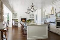 Gourmet Kitchen with Raised White Brick Fireplace ...
