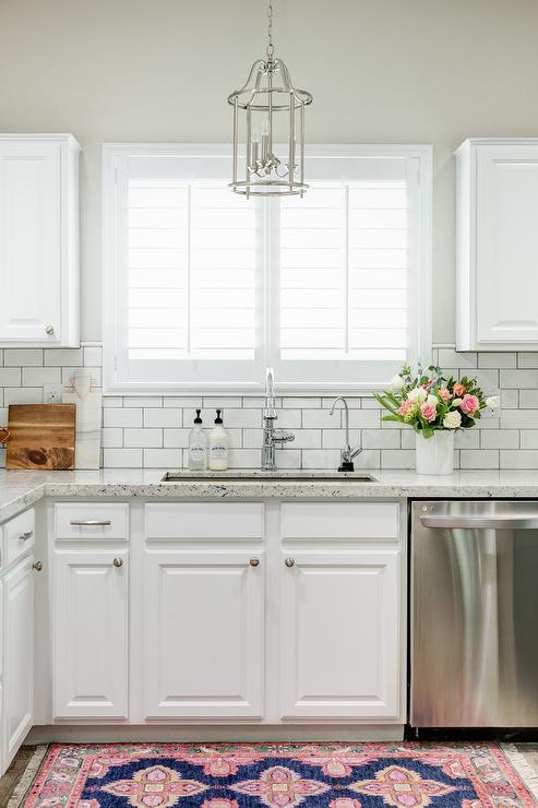 chic white kitchen features white cabinets paired white granite white kitchen cabinet glass metal backsplash tile backsplash