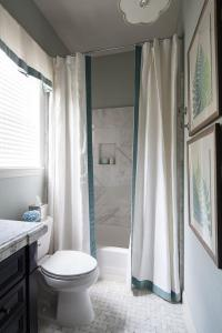 Drop In Shower with Two Shower Curtains Accented with ...