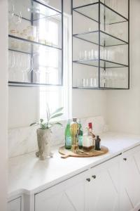 Black and Gold Butler Pantry with Brass and Glass Shelves ...