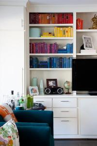 Living Room Built in Bookshelf with Books Organized by ...
